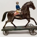 Althof Bergmann Early American Tin Articulated Horse and Rider Bell Toy